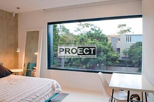 коттедж с панорамными окнами     спальня
